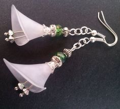 Lucite Lily Earrings These stunning handcrafted silver, lucite and crystal dangling flower earrings hang from silver plate hooks. They have white