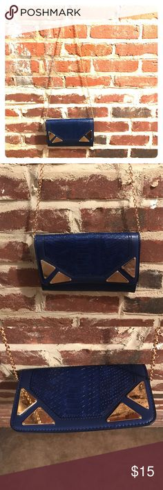 Cobalt Metallic Clutch Get ready to be the party's show stopper! This beauty is cute and Chic. Compliments will be given left and right! Get it girl! Inside material is stripe black and white.. Bags Clutches & Wristlets
