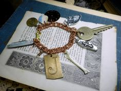 The JaCk The RiPPeR Bracelet. Vintage Charms Bones Curiosities Macabre WearableArt OOAK England Key MOP mini Pocketknife Heart Coffin clock