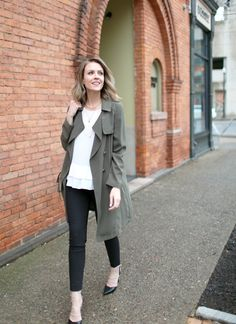 Transitional spring style: draped trench coat, ruffled top, cropped trousers