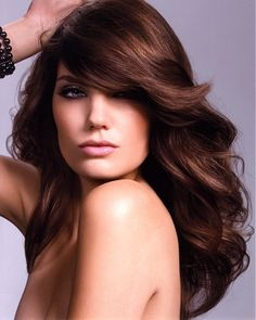 A long brown straight wavy coloured hairstyle by Royston Blythe