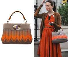 """Blair couldn't have found a better bag to coordinate with her outfit than this orange and taupe patterned top handle bag in episode 5 of season 6 of Gossip Girl, """"Monstrous Ball"""". Bvlgari Isabella Rosselini Chevron Bag in Clay Lace Worn with Jason Wu dress"""