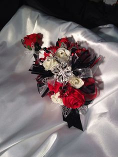 Prom corsage in black white red and silver from Hen House Designs. https://www.etsy.com/shop/LisasHenHouseDesigns