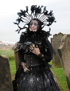 Debra Scarsbrook at the Whitby Festival with feathers in a Neo-Victorian outfit