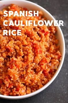 Spanish Cauliflower Rice A quick and easy side dish that is chuck full of veggies, but doesn't taste like it? Sign us up. Our Spanish Cauliflower rice is the perfect low-carb compliment to any Spanish main dish. Spanish Cauliflower Rice, Cauliflower Recipes, Riced Cauliflower, Gourmet Recipes, Low Carb Recipes, Healthy Recipes, Quick Recipes, Salad Recipes, Clean Eating Snacks