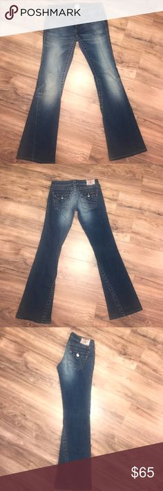 "True Religion Jeans 👖 Joey  Bootcut Flare These are a beautiful distressed blue with orange and yellow stitching. Worn several times but well taken care of and show no signs of wear. No wear fading or loose stitching. Size 25. 13.5"" waist. 7"" rise. 32"" inseam. True Religion Jeans Boot Cut"