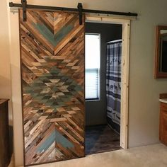 Rustic Tribal Aztec Sliding Barn Door DESCRIPTION Sliding barn doors are the perfect way to separate a room while also serving as a gorgeous piece of art. This is a completely one of a kind barn door with a unique design. You will find no other like it. Rustic Design, Rustic House, Rustic Home Decor, Barn Door Designs, Handmade Home Decor, Doors, Home Decor Accessories, Wood Doors, Door Design