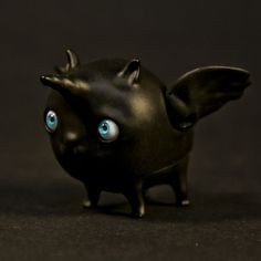 A little home demon can be made in any colour.  Wings and eyes can be put in various positions, as they are movable.  What animal is he? A unicorn,