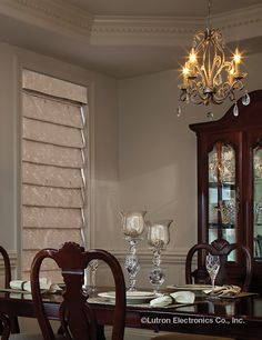 Elegent #RomanShades are the perfect compliment for your dining room. www.lutron.com