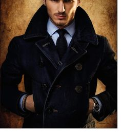Yes: Updated peacoat.  Looks like heavy gauge denim.  With rustic treatment anchor buttons.   Tres chic