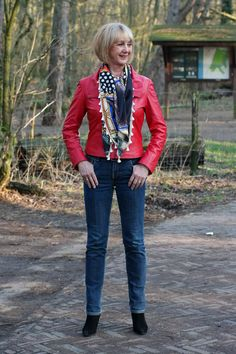 Red leather jacket, scarf and jeans.