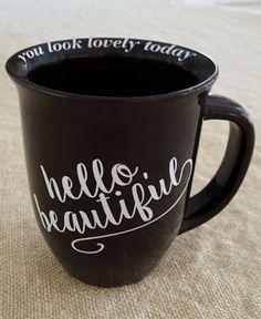 "Large ""HELLO, BEAUTIFUL"" coffee mug. Around the inside lip of the mug, ""you look lovely today""."