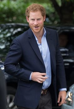Britain's Prince Harry reacts as he arrives for a visit to County Hall and The London Eye in central London on October 10, 2016.