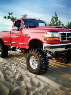 Lifted Red Ford Powerstroke F-350