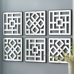Mirrored Wall Hangings. Set of 2 for $80. Saw something similar at Horchow.
