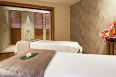 Couples treatment room with private shower inside the Spa at Koloa Landing Resort