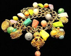VINTAGE 60s Etruscan revival Gold Tone Charm necklace with Pastel Stones, Lucite Beads and Elaborate Charms