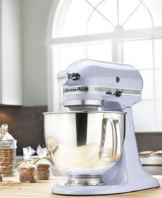 KitchenAid KSM150PS Artisan 5 Qt. Stand Mixer $349.99 Retro styled and easy to use, the KitchenAid Artisan stand mixer is the perfect kitchen companion. Employing a unique tilting head to facilitate bowl and content removal, this mixer is undeniably handy. 1-year hassle-free replacement warranty. Model KSM150PS.