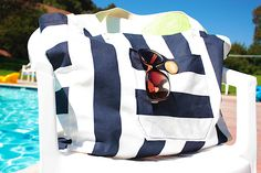 Canvas Beach Bag - looks like a very easy bag to make..really cute with the front outer pocket and button!