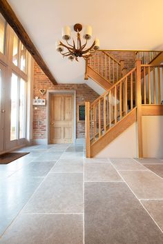 Farrow Grey tumbled limestone tiles available as large grey flagstone flooring. Order your FREE sample of Farrow Grey tumbled limestone tiles. Entrance Hall Decor, House Entrance, Entrance Halls, Large Floor Tiles, Flagstone Flooring, Hallway Flooring, Bungalow Renovation, Farmhouse Flooring, Hallway Designs