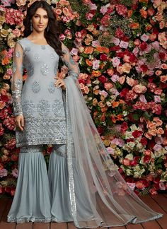 Dusty Blue Grey Embroidered Gharara Suit features a net kameez with santoon inner, georgette gharara bottom and net dupatta. Embroidery work is completed with thread and sequins embellishments on this style. Pakistani Formal Dresses, Pakistani Wedding Outfits, Indian Dresses, Indian Outfits, Pakistani Gharara, Party Wear Dresses, Bridal Dresses, Gharara Pants, Sharara Suit