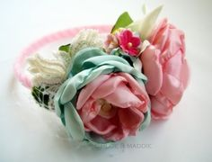 I think these are just the same as the ones we have all been making. Only these are all made with tiny petals. Vintage Inspired fabric flowers headband FARRAH, via Etsy.