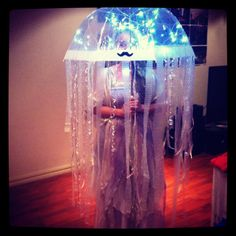 Under the sea 'Jelly Fish' costume. You'll need: 1 - Clear umbrella. 2 - Bubble wrap cut in strips. 3 - Colored ribbon. 4 - Sticky tape. 5 - Fairy lights, battery operated.