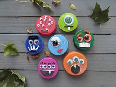 Plastic Lid Monsters or use can lids that have been opened with the safety can opener no raw edges, paint the lids & decorate