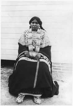 Seated Potawatomi woman in traditional dress - ca. 1920s
