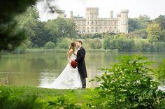 A cheeky kiss by the lake at Eastnor Castle  www.eastnorcastle.com #eastnorcastle A romantic, fairytale exclusive-use castle wedding venue.