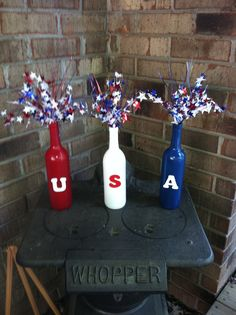 "Fourth of July. Spray paint wine bottles, hot glue painted wooden letters, ""spangles"" from the Dollar Tree. Something to do with all my wine bottles July 4th Holiday, Fourth Of July Decor, 4th Of July Decorations, Wine Bottle Art, Painted Wine Bottles, Wine Bottle Crafts, Wine Bottles Decor, Bottle Centerpieces, Wine Decor"