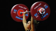 Zoe Smith competes in women's 58kg Weightlifting