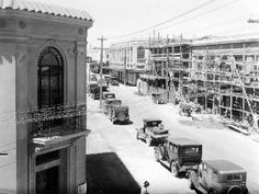 The photograph shows that the devastation caused to the Napier central business district by the 3 February 1931 Hawke's Bay earthquake has been cleaned up and the construction of new buildings begun. Central Business District, Buildings, February, Photograph, Art Deco, Street View, Construction, Outdoor, Fotografia