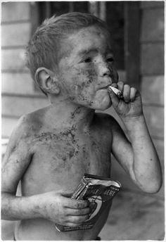Boy covered by dirt smoking cigarette with one hand, holding can of tobacco in other, from the Cornett Family series, Appalachia, Kentucky by William Gale Gedney. Old Pictures, Old Photos, Shorpy Historical Photos, Diane Arbus, Foto Art, We Are The World, Thats The Way, Interesting History, Interesting Photos