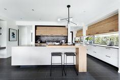 modernist black and white kitchen with shiny black splashback tiles from metricon