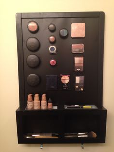 $12 Magnetic Chalk Board from Ikea, and a $5 pack of sticky magnets and I made my own magnetic makeup board with brush holders. (Huge Tip: Make sure the magnets are strong enough to hold to the board and superglue them to your makeup because the adhesive isn't always dependable. Also, if you need to travel, just take the same kind of material as the board and make a bottom in your makeup bag, then your makeup will remain organized when traveling.)