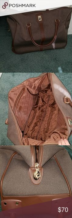 London For travel bag Brown travel bag. Has wheels and pull put handle. Also can bet carried duffle bag style. Inside has one big compartment and then on smaller zipper pocket. Some wear and tear from travel but very minor. Flaws shown in pictures. London Fog Bags Travel Bags