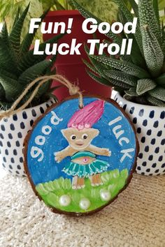 Adorable lucky troll wood slice ornament pops with detail! Pink sparkly faux crystals, pearls and a lively glitter wash makes this cute creation extra special! Makes a fun gift or something unique for the troll lover. Comes in a complimentary blue drawstring pouch. Fun for kids or young-at-heart-adults. Complementary personalization available on the back. Wooden Ornaments, Personalized Ornaments, Key Tattoos, Small Gifts, Unique Gifts, Wood Slices, Good Luck, Handmade Decorations, Sell On Etsy