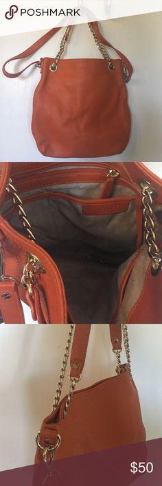 "Michael Kors Small Orange Handbag Gold Fun orange handbag! Shoulder strap and gold chain strap. Fair condition. Missing ""MK"" charm, comes with MK storage bag. MICHAEL Michael Kors Bags Shoulder Bags"