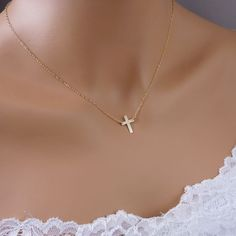 Tiny Gold Cross Necklace, 14k Gold Filled Cross Charm, Small gold cross necklace. $35.00, via Etsy.