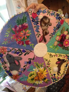 Fantastic needlepoint Easter tree skirt.  Canvas by Ann Wheat Pace; stitch guide and stitched by Laurie Walden.