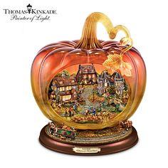 Beautiful glass pumpkin features a sculpted recreation of a Thomas Kinkade autumn village.  Features 2 horse-drawn wagons that circle around the pumpkin.