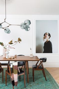 Tagged: Dining Room, Table, Ceiling Lighting, Light Hardwood Floor, Lamps, Chair, and Pendant Lighting. Photo 1 of 19 in Noe Valley Parisian Atelier by Regan Baker Design