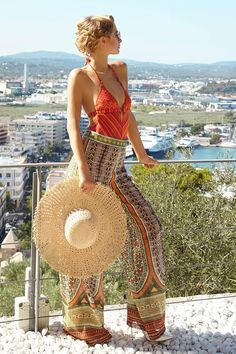 Paris Hilton wearing Jimmy Choo Anouk Pointed Toe Pumps in White, Marc Jacobs Gold and Silver Cat Eye Sunglasses, Missoni Red Lurex Swimsuit, Valentino Print Silk Pants and El Corde Ingles Hat