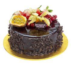 Patisserie Valerie - Special Occasion Cakes - Valerie Chocolate Mousse, A mousse made with dark Belgian Chocolate and fresh cream on a thin layer of chocolate sponge, coated with a dark chocolate glaze and fresh fruits.