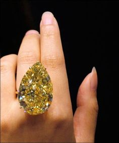 A rare 110.03 carat diamond graded 'Fancy Vivid Yellow,' the highest color grading for a yellow diamond. Valued at between 11-15 million dollars.