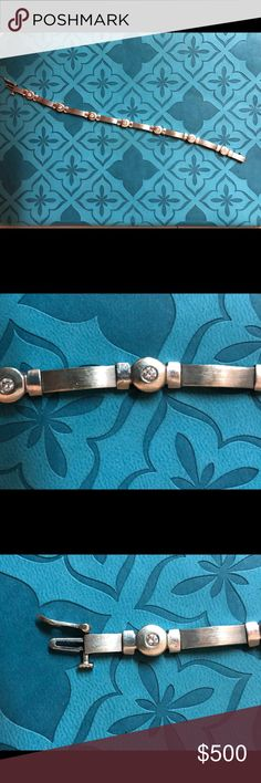 White gold and genuine Diamond bracelet Seven genuine diamonds bezel set in white gold circles and satin finish bars. I'm unsure of the total carat weight but as you can see the diamonds are a decent size cut diamond, not diamond chips Jewelry Bracelets