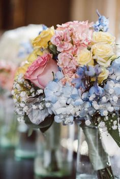 "Makho+Carl's wedding. ""For my braidsmaids I wanted them to have a bit of color so they carried a bouquet that was mixed with soft yellow roses, pale pink ranunculus, ivory hydrangea, dusty miller, and touches of babies breath."" Makho Ndlovu"