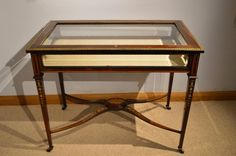A Superb quality Victorian Period rosewood ormolu mounted inlaid bijouterie cabinet of large proportions.