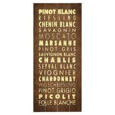 "Express your taste for fine white wines with this plank-style wall decor, showcasing a vino-inspired text motif.  Product: Wall decorConstruction Material: Wood Features: Ready to hangDimensions: 24"" H x 10"" W"